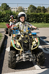 Two boys with quadbikes on driver training area