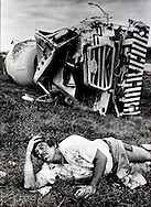 Jorge Rosquere, 36, waits to be treated by fire rescue after crawling out of his demolished cement truck on state road 836 in Miami, 1985.