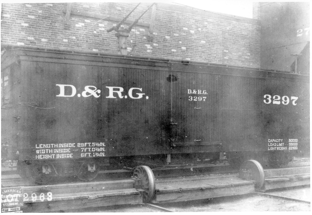 "Side view of box car #3297 on transfer table at American Car & Foundry Co. factory in St. Louis, MO.<br /> D&RG  AC&F Co., St. Louis, MO  1903<br /> In book ""Narrow Gauge Pictorial, Vol. III: Gondolas, Boxcars and Flatcars of the D&RGW"" page 122"
