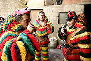 """Drinking alcohol is part of the ritual each time they stop their roaming in the house of those who don't wear the """"careto"""" desguise"""""""