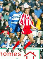 Photo: Scott Heavey.<br />Reading v Stoke City. Nationwide Division One. 13/03/2004.<br />Sebastian Svard of Stoke (R) beats John Salako in the air
