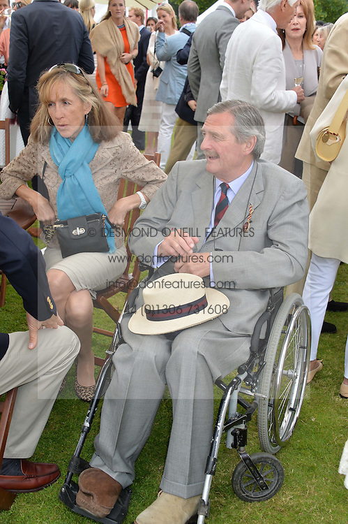 The HON.MARK & MRS VESTEY at the Cartier Queen's Cup Final polo held at Guards Polo Club, Smith's Lawn, Windsor Great Park, Egham, Surrey on 15th June 2014.