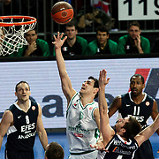 Efes Pilsen's Igor RAKOCEVIC (L), Bootsy THORNTON (R) and Montepaschi Siena's Nikos ZISIS (C) during their Turkish Airlines Euroleague Basketball Top 16 Group G Game 1 match Efes Pilsen between Montepaschi Siena at Sinan Erdem Arena in Istanbul, Turkey, Wednesday, January 19, 2011. Photo by TURKPIX