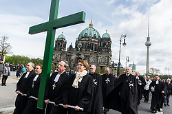 April 14, 2017 - Berlin, Germany - Protestant pastors carry a cross during a procession through the city center to mark Good Friday on April 14, 2017 in Berlin, Germany. Christians across the globe will celebrate Easter throughout this weekend, including Good Friday, when according to Christian tradition Jesus Christ was crucified and died. (Credit Image: © Markus Heine/NurPhoto via ZUMA Press)