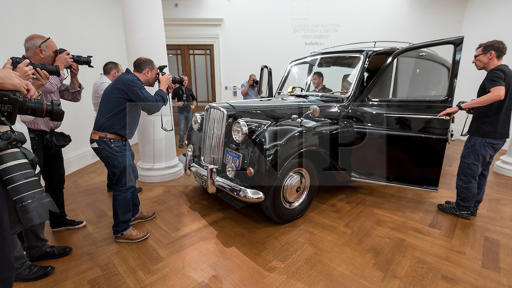 """© Licensed to London News Pictures. 12/08/2016. London, UK. Media photograph John Lennon's iconic 1956 Austin Princess Limousine Hearse, immortalised in John Lennon and Yoko Ono's 1972 film """"Imagine"""" (est. GBP 250,000) at the photocall for classic cars at Sotheby's, New Bond Street, ahead of their auction on 7 September in Battersea Park. Photo credit : Stephen Chung/LNP"""