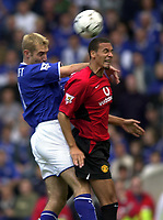 Photo: Richard Lane.<br />Leicester City v Manchester United. Barclaycard Premiership. 27/09/2003.<br />Rio Ferdinand is challenged by James Scowcroft.