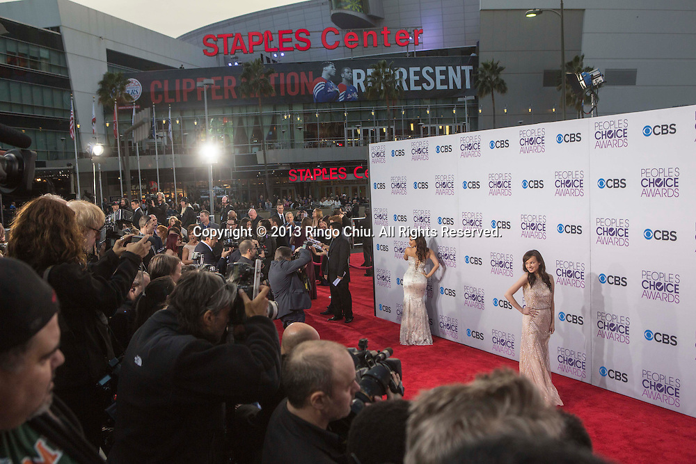 Mayra Veronica and Ashley Rickards arrive at the 39th Annual People's Choice Awards at Nokia Theatre L.A. Live on Wednesday January 9, 2013 in Los Angeles, California, United States. (Photo by Ringo Chiu/PHOTOFORMULA.com)