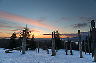 The Playground of the Gods (Kamui Mintara) sculptures after sunset at the Burnaby Mountain Conservation Area (Burnaby Mountain Park) in Burnaby, British Columbia, Canada.  These carved wooden poles were created by Japanese sculptors Nuburi Toko and Shusei (his son) and are meant to illustrate goodwill between Burnaby and its Japanese sister city Kushiro.