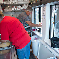 Brenda Robertson, left, and Wayne Robertson hand out free ice cream to students in the Tasty Shack at the University of New Mexico-Gallup campus located in Gallup, New Mexico.