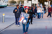 12 MARCH 2012 - PHOENIX, AZ:      Striking bus drivers walk a picket line in front of the Veolia Transportation bus barns in Phoenix, AZ, Monday. Nearly 900 bus drivers from Amalgamated Transit Union Local 1433  are on strike against Veolia Transportation which is contracted to provide bus service for Valley Metro, the bus service that spans the Phoenix metropolitan area. The routes affected by the strike are in Phoenix and the suburbs of Tempe and Glendale. According to the union, the strike was called because of Veolia's conduct during negotiations, which have lasted more than two years. The union has filed Unfair Labor Practices charges against Veolia with The National Labor Relations Board and the NLRB is taking Veolia before an Administrative Law Judge on April 3, 2012 to answer the charges.  PHOTO BY JACK KURTZ