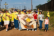 17 APRIL 2005 - NACO, AZ: Progressive Christians on the US side of the US/Mexico border march to the border in Naco, AZ to support migrants' rights. The Christians had gathered to protest the presence of the  Minuteman Project in Naco. The Minuteman volunteers were hunting migrants who crossed the border outside of Naco.      PHOTO BY JACK KURTZ