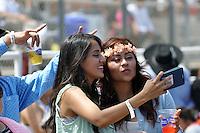 Selfies at the popular Dia de la Familia concert at the Salinas Sports Complex.