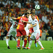 Galatasaray's Hamit Altintop (C) and Sivasspor's Ziya Erdal (R) during their Turkish Super League soccer match Galatasaray between Sivasspor at the AliSamiYen Spor Kompleksi TT Arena at Seyrantepe in Istanbul Turkey on Sunday 05 May 2013. Photo by TURKPIX