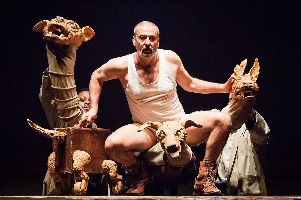With its dark and sardonic wit, documentary footage, spectacular animation, poignant puppetry and superb actors, Ubu and the Truth Commission draws on both the historical archive of the hearings of South Africa's Truth and Reconciliation Commission and on the dramatic figure of Ubu Roi, a licentious buffoon created by the playwright Alfred Jarry.  Picture shows: Dawid Minnaar (Pa Ubu), Mongi Mthombeni, Gabriel Marchand and Manideli Maseti.<br /> (c) Sally Jubb / StockPix.eu