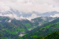 Peaks of the Himalayas near Pokhara, Nepal shrouded in fog.