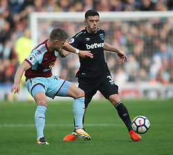 Aaron Cresswell of West Ham United (R) and Johann Gudmundsson of Burnley in action - Mandatory by-line: Jack Phillips/JMP - 14/10/2017 - FOOTBALL - Turf Moor - Burnley, England - Burnley v West Ham United - English Premier League