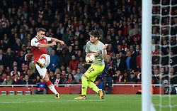 Arsenal's Sead Kolasinac (left) scores his side's first goal of the game