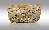 Picture & image of Hittite monumental relief sculpted orthostat stone panel from Water Gate Limestone, Karkamıs, (Kargamıs), Carchemish (Karkemish), 900-700 BC.  Anatolian Civilisations Museum, Ankara, Turkey.<br /> <br /> The figure sitting on a stool to the left of the table holds a goblet in his right hand which he raised upwards. Behind, there is a servant with a fan in his hand. On the other side of the table is another servant waits with a vessel in the hands. The rightmost figure plays a Saz (a stringed musical instrument) with the tassel on the handle. <br /> <br /> On a gray background. .<br />  <br /> If you prefer to buy from our ALAMY STOCK LIBRARY page at https://www.alamy.com/portfolio/paul-williams-funkystock/hittite-art-antiquities.html  - Type  Karkamıs in LOWER SEARCH WITHIN GALLERY box. Refine search by adding background colour, place, museum etc.<br /> <br /> Visit our HITTITE PHOTO COLLECTIONS for more photos to download or buy as wall art prints https://funkystock.photoshelter.com/gallery-collection/The-Hittites-Art-Artefacts-Antiquities-Historic-Sites-Pictures-Images-of/C0000NUBSMhSc3Oo