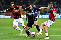 Lucas Biglia of AC Milan, Ivan Perisic of Internazionale, Davide Calabria of AC Milan compete for the ball during the Serie A 2018/2019 football match between Fc Internazionale and AC Milan at Giuseppe Meazza stadium Allianz Stadium, Milano, October, 21, 2018 <br />  Foto Andrea Staccioli / Insidefoto