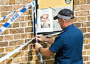 © Licensed to London News Pictures. 09/09/2014. Hanwell, UK. A police officer puts up a cordon next to a missing person poster of Alice Gross.  Police continue to cordon off a section of the Grand Union Canal in Isleworth in the search for missing school girl Alice Gross today 9th September 2014.  Alice Gross of Hanwell, west London, was last seen by her family at about 13:00 BST on 28 August. CCTV footage shows her walking along the Grand Union Canal tow path near the Holiday Inn at Brentford Lock between 13:30 BST and 17:30 BST.. Photo credit : Stephen Simpson/LNP