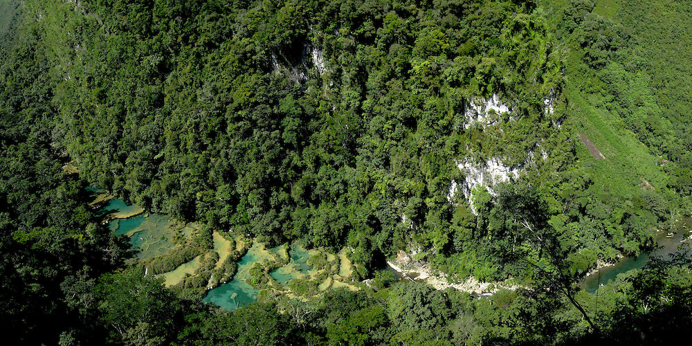 Semuc Champey, Guatemala, seen from above.  The natural monument is a 300-metre limestone bridge over the Cahabón River, with a series of water pools running above.<br /> <br /> Panoramic image created from multiple exposures.
