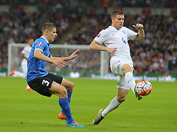 James Milner of England is challenged by Aleksandr Dmitrijev  of Estonia - Mandatory byline: Paul Terry/JMP - 07966 386802 - 09/10/2015 - FOOTBALL - Wembley Stadium - London, England - England v Estonia - European Championship Qualifying - Group E
