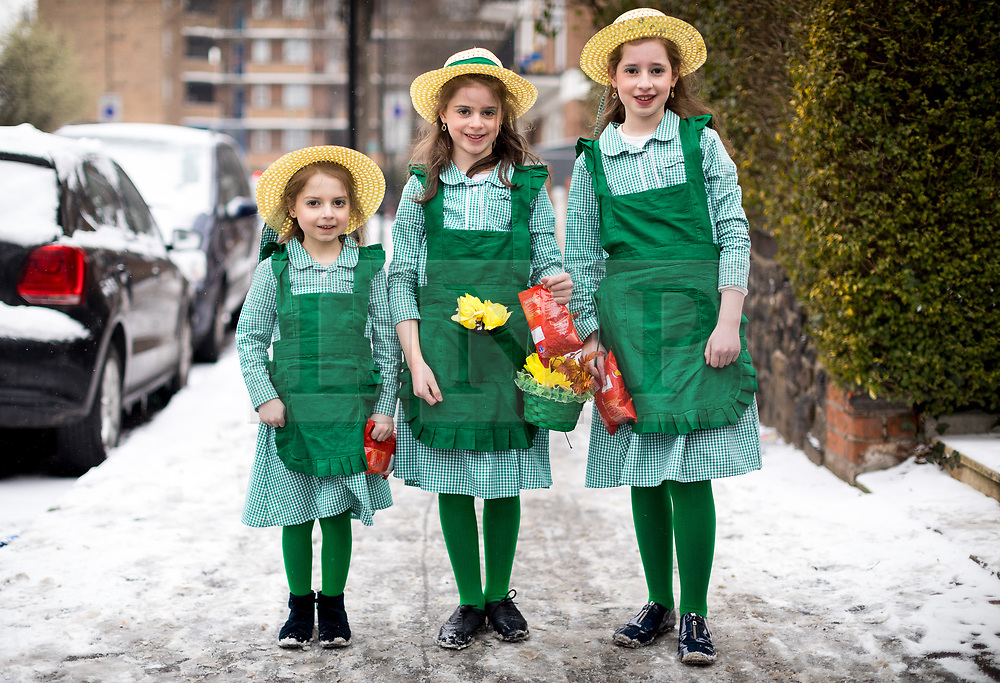 © Licensed to London News Pictures. 01/03/2018. London, UK. Jewish Children in fancy dress celebrate the festival of Purim in the streets of Stamford Hill in north London. Purim is celebrated by Jewish communities around the world with parades, parties in costume and the exchange of gifts. The event is documented in the Book of Esther, and commemorates the defeat of Haman, the advisor to the Persian king, and his plot to massacre the Jewish people 2,500 years ago. Photo credit : Tom Nicholson/LNP