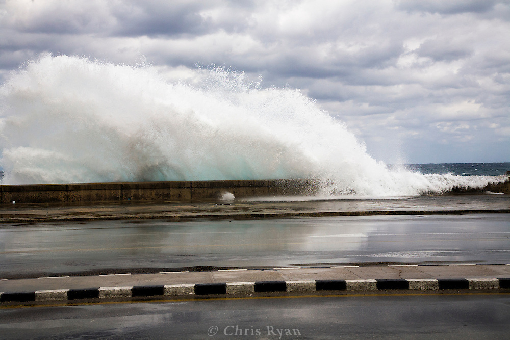 Waves crashing against the malecon during storm, Havana, Cuba