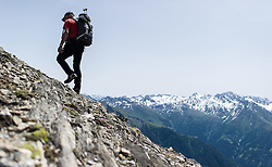 THEMENBILD - Nationalpark Hohe Tauern ist der groesste Nationalpark Oesterreichs und umfasst Teile des zentralalpinen Hauptkamms der Ostalpen. Das Bild wurde am 04. Julii 2014 aufgenommen. im Bild Wanderer // THEMES PICTURE - High Tauern National Park, which is the largest National Park in Austria. The High Tauern are a mountain range on the main chain of the Central Eastern Alps. The image was taken on july, 04th, 2014. Picture shows Hiker, AUT, EXPA Pictures © 2014, PhotoCredit: EXPA/ Michael Gruber