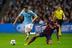 Man City Defender Micah Richards (ENG)  is fouled by Barcelona Defender Daniel Alves (BRA) - Photo mandatory by-line: Rogan Thomson/JMP - Tel: 07966 386802 - 18/02/2014 - SPORT - FOOTBALL - Etihad Stadium, Manchester - Manchester City v Barcelona - UEFA Champions League, Round of 16, First leg.