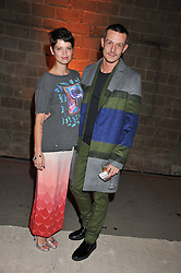 JONATHAN SAUNDERS and PIXIE GELDOF at a dinner hosted by Jonathan Saunders, Fantastic Man & Selfridges to celebrate Jonathan Saunders AW13 Menswear collection and London Collections held at the Old Selfridges Hotel,  Orchard Street, London on 8th January 2013.