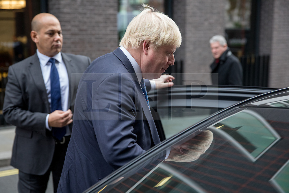 © Licensed to London News Pictures. 02/12/2016. London, UK. Foreign and Commonwealth Secretary Boris Johnson leaves Chatham House after making his first set piece speech as Foreign and Commonwealth Secretary. Photo credit : Tom Nicholson/LNP