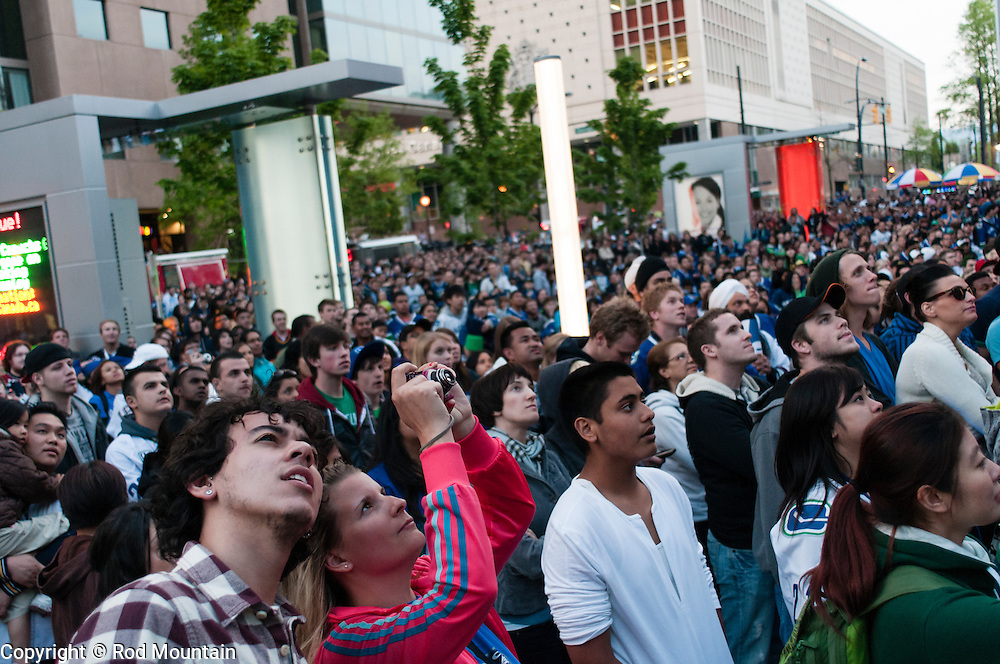 A crowd gathered outside the CBC studio in Vancouver enjoying a hockey playoff game.