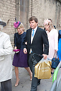 GUESTS LEAVING THE RECEPTION with goody bags, The Royal Wedding of Prince William and  Catherine Middleton. Scenes around Buckingham Palace and the Mall.   London. 29 April 2011. , -DO NOT ARCHIVE-© Copyright Photograph by Dafydd Jones. 248 Clapham Rd. London SW9 0PZ. Tel 0207 820 0771. www.dafjones.com.