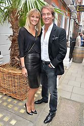 TIM & MALIN JEFFERIES at the launch of the new collection from Limoland held at Anderson & Sheppard's Haberdashery, 17 Clifford Street,London on 16th June 2014.