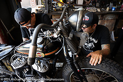 Custom bike builder and musician Xavier Muriel lends a hand to Billy Lane in Billy's new Columbia, TN shop after the move from Florida. Monday, May 24, 2021. Photography ©2021 Michael Lichter.