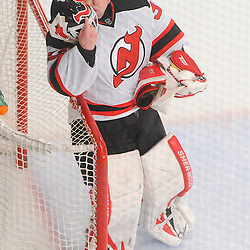 May 14, 2012: New Jersey Devils goalie Martin Brodeur (30) checks his mask after it was knocked off during first period action in game 1 of the NHL Eastern Conference Finals between the New Jersey Devils and New York Rangers at Madison Square Garden in New York, N.Y.