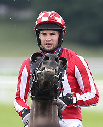 Love Island's Chris Hughes rides Carnageo after The Best Western Hotels & Macmillan Ride of their Lives, during the Macmillan Charity Raceday at York Racecourse.