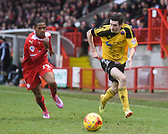 Jamie Murphy takes on Lewis Young during the Sky Bet League 1 match between Crawley Town and Sheffield Utd at Broadfield Stadium, Crawley, England on 28 February 2015. Photo by David Charbit.