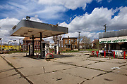 "Deserted petrol station on Grand River road near Downtown Detroit. Known as the world's traditional automotive center, ""Detroit"" is a metonym for the American automobile industry and an important source of popular music legacies celebrated by the city's two familiar nicknames, the Motor City and Motown. Many neighborhoods remain distressed since the collapse of the motor industry. The state governor declared a financial emergency in March 2013, appointing an emergency manager. On July 18, 2013, Detroit filed the largest municipal bankruptcy case in U.S. history."