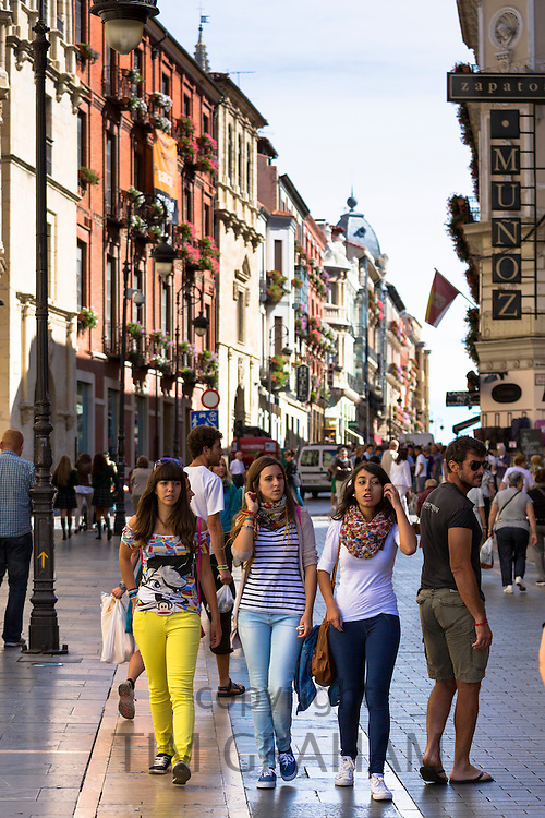 Young Spanish girls in busy main street Calle Ancha in Leon, Castilla y Leon, Spain
