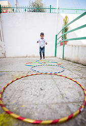 17 February 2020, Zarqa, Jordan: A boy jumps through hoops at the Lutheran World Federation community centre in Zarqa. Through a variety of activities, the Lutheran World Federation community centre in Zarqa serves to offer psychosocial support and strengthen social cohesion between Syrian, Iraqi and other refugees in Jordan and their host communities.
