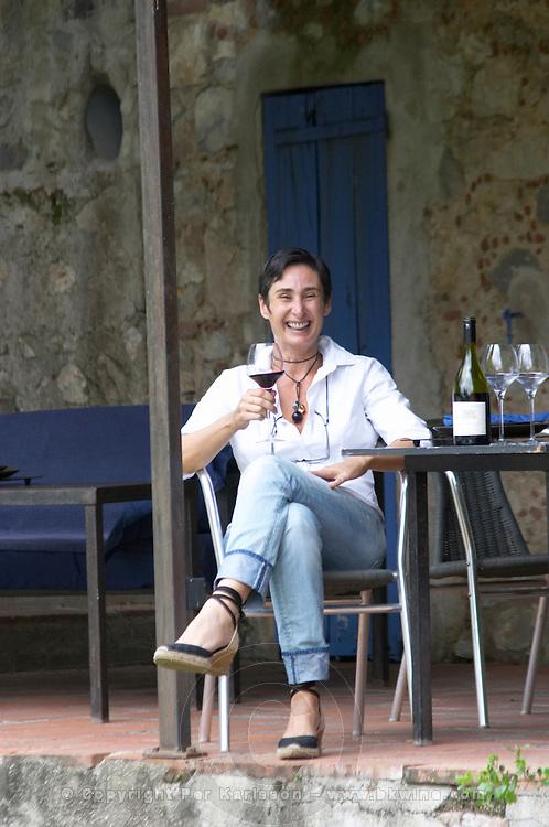 Estelle Daure, of the owner family by the pond at the restaurant. Chateau de Jau, Cases de Pene, Roussillon, France