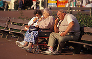 Middle-aged and elderly visitors eat ice-cream cones on the seafront of Great Yarmouth, on 25th May 1992, in Great Yarmouth, England.