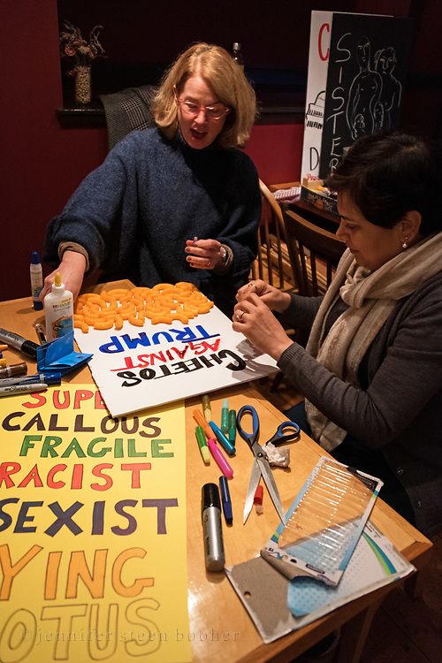 Bar Harbor, Maine, USA. 17 January, 2019. Women gather at a local cafe to make protest signs for the upcoming Women's March.