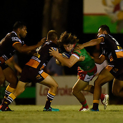 BRISBANE, AUSTRALIA - FEBRUARY 18: Peter Gubb of Wynnum Manly is tackled by Brisbane Broncos players during the QLD Rugby League Intrust Super Cup Pre-Season match between Wynnum Manly and Brisbane Broncos at Kougari Oval on February 18, 2017 in Brisbane, Australia. (Photo by Patrick Kearney/Wynnum Manly Seagulls)
