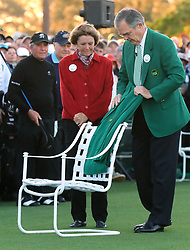 Gary Player, Jack Nicklaus, and Arnold Palmer's wife Kathleen look on as Augusta National Chairman Billy Payne places Palmer's green jacket on his chair at the first tee during the honorary start of the Masters at Augusta National Golf Club on Thursday, April 6, 2017, in Augusta, Ga. (Photo by Curtis Compton/Atlanta Journal-Constitution/TNS)  *** Please Use Credit from Credit Field ***