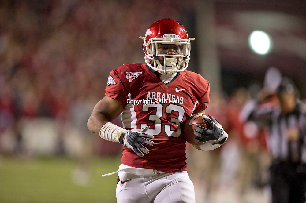 Nov 12, 2011; Fayetteville, AR, USA;  Arkansas Razorback running back Dennis Johnson (33) runs the ball for a touchdown during the first half of a game against the Tennessee Volunteers at Donald W. Reynolds Razorback Stadium. Arkansas defeated Tennessee 49-7. Mandatory Credit: Beth Hall-US PRESSWIRE