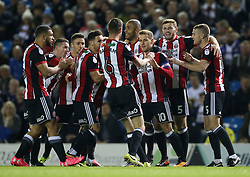 Sheffield United's Billy Sharp (third right) celebrates scoring his side's first goal of the game during the Sky Bet Championship match at Elland Road, Leeds.