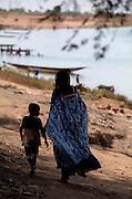 Woman and Child walking Home - Matam